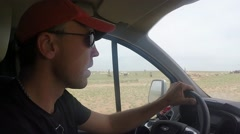 Man Driving Car Through Steppe Side View From Front Seat Pov Stock Footage