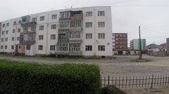 Motion on Streets of Mongolian Town With Small Multistory Buildings Stock Footage