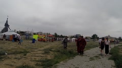 People in National Clothes Walking Along Road Near Stadium Next to Mongolian Stock Footage