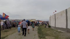 Many People Near Mongolian Yurts Next to Stadium During Festival Stock Footage