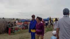 A Lot of People Near Mongolian Yurts Next to Stadium During Festival Stock Footage