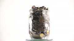 Time Lapse of Falling Coins in the Jar Stock Footage