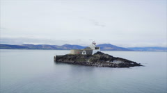 Surface level video of ocean and lighthouse Stock Footage