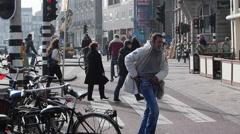 Pedestrian crossing, Amsterdam, Holland. Prins Hendrikkade Stock Footage