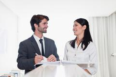 Business people smiling together Stock Photos