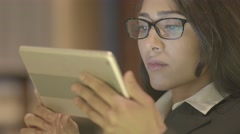 Portrait of african american women using tablet computer searching the internet  Stock Footage