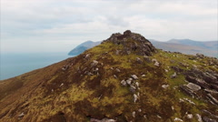 Tilt up footage of mountains by ocean Stock Footage