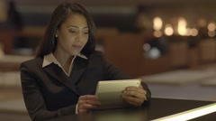 young african american female searching the web on tablet in the city at night - stock footage