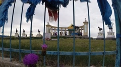 Mongolian Specific Monument in Steppe Under Heavy Sky Through Bars of Fence Stock Footage
