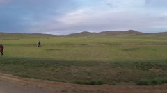 Movement Along Road in Steppe Past Standing People Stock Footage