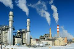 Coal Fossil Fuel Power Plant Smokestacks Emit Carbon Dioxide Pol - stock photo