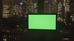 Computer screen isolated with green-screen background in modern city office Stock Footage