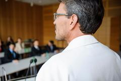 Doctor addressing audience in room - stock photo