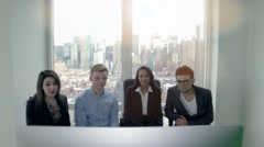 diverse multi ethnic group of young business people having a meeting in office - stock footage
