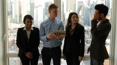 teamwork of multi ethnic group analyzing together business strategy in office  - stock footage