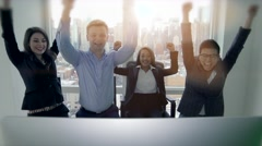 young diverse multi ethnic group of business people sharing exciting news - stock footage