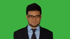 Portrait of young asian business man isolated on green screen background Stock Footage