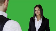 Young attractive businesswomen having a conversation isolated on green-screen Stock Footage