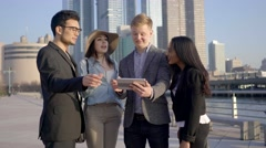 Multi ethnic group of young professionals standing together talking about life Stock Footage