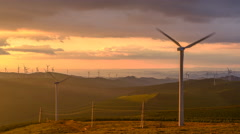 Timelapse of Windmill Turbines or Aerogenerators in Mountains at Sunset, China. - stock footage