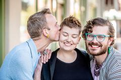 Friendly Kiss Among Friends Stock Photos