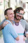 Gender Fluid Young Men Embracing Stock Photos