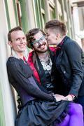 A Kiss Among Three Gender Fluid Friends Stock Photos