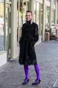 Gender Fluid Young Man in Coat Stock Photos