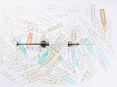 Close up of syringe and vials Stock Photos