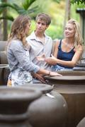Couple shopping for planters - stock photo