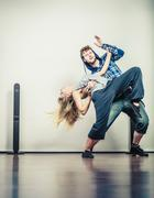 Couple of young man and woman dancing hip-hop Stock Photos