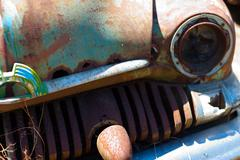 Close up of rusted vintage car - stock photo