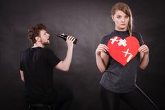 Sad woman and man addicted to alcohol. Broken heart. - stock photo