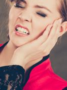 Negative emotion. Woman having tooth ache. Stock Photos