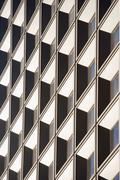 Tilted view of skyscraper windows Stock Photos
