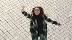 Young Woman Smiling and Waving Stock Footage