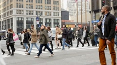 new york city street view. people crossing street going to work - stock footage