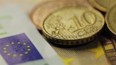 Many euro banknotes and coins, closeup shot Stock Footage