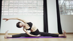 Yoga professional gymnast training exercising in gym, slow motion. Stock Footage