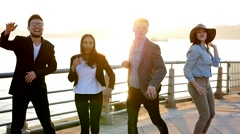 Multi ethnic group of happy friends dancing cheerful together  Stock Footage