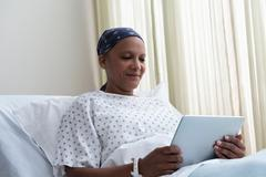 Female hospital patient using digital tablet - stock photo