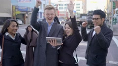 happy group of young people cheering together after getting striking news - stock footage