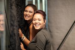 Women feeling carpet in store - stock photo