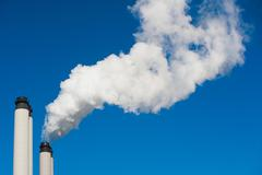 Smoke billowing from industrial plant Stock Photos