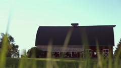 Big Red Barn through the Tall Grass Stock Footage