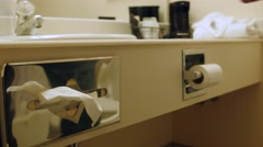 A man grabs kleenex while in a hotel room Stock Footage
