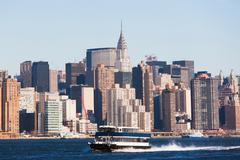 Ferry boat and New York City skyline - stock photo