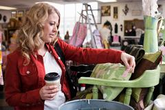 Woman shopping in thrift store - stock photo