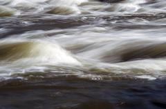 Abstract landscape of the river rapids - stock photo
