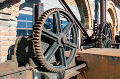 Old rusty gears, machinery parts. Stock Photos